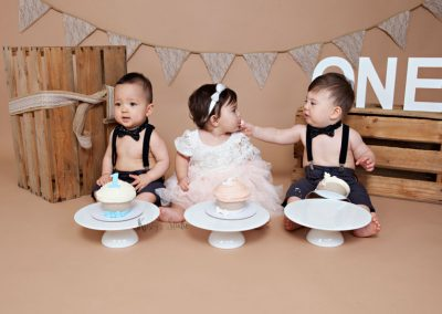 Cake-Smash-girl-and-two-boys-three-babies-brown-rustic-wooden Baby Photography Sydney