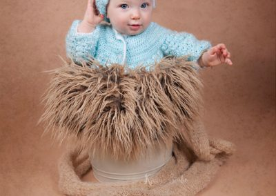 sitter-girl-bucket-brown-green-hat Baby Photography Sydney