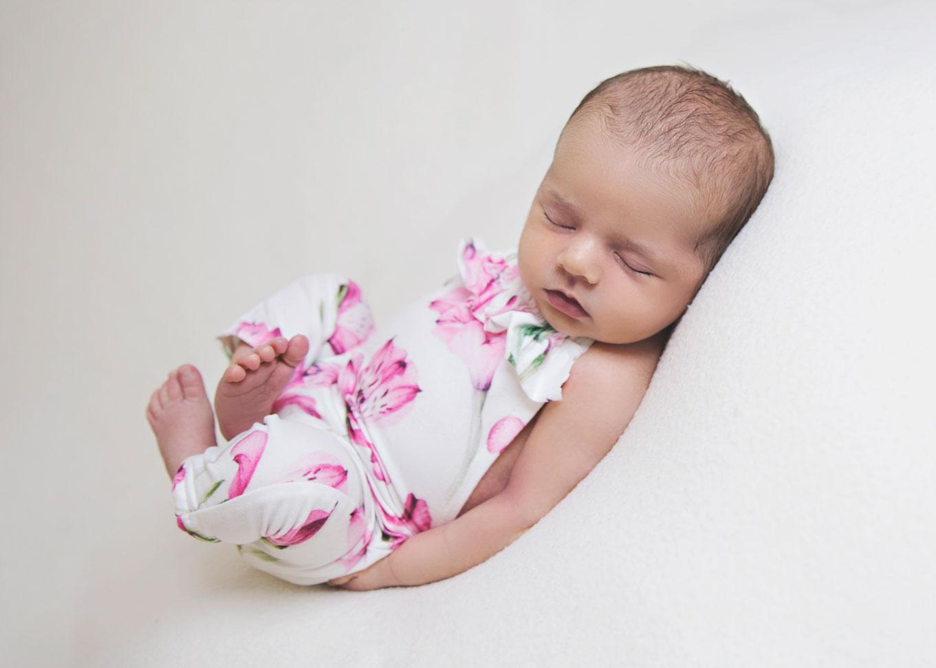 newborn girl in onesie