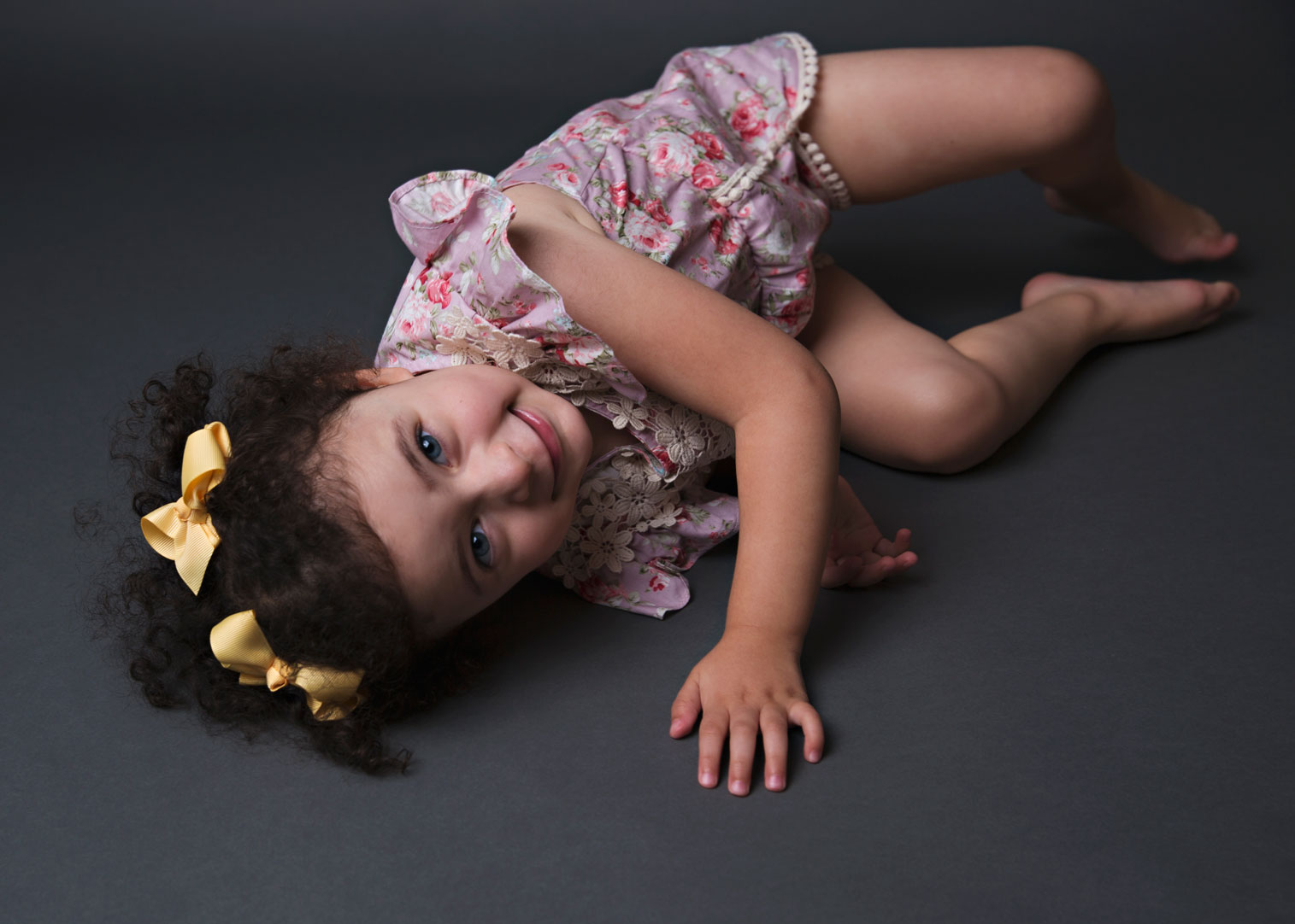 Young girl lying on floor