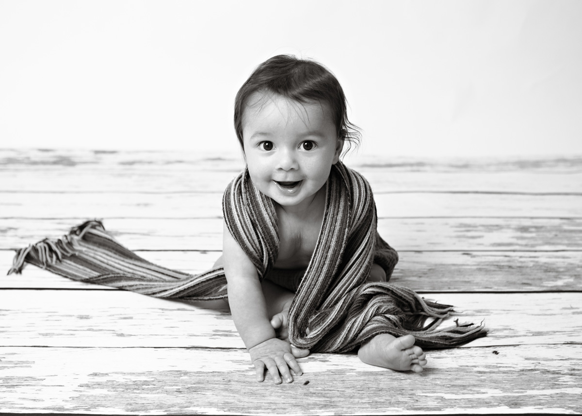 baby-boy-with-scarf-black-and-white